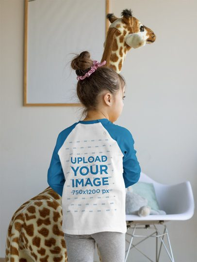 Back-View Mockup of a Little Girl Wearing a Raglan T-Shirt at Home 31690