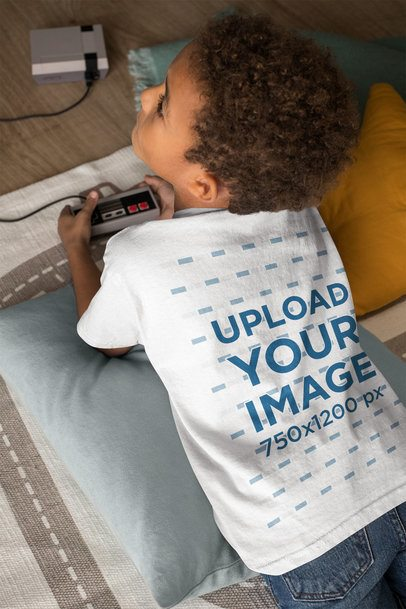 Back-View Tee Mockup of a Little Boy Playing Video Games 31640