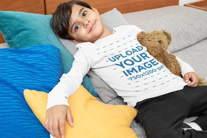 Mockup of a Boy with a Long-Sleeve Tee Lying on a Bed 32173