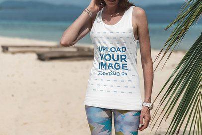 Mockup of a Woman Wearing a Customizable Tank Top at a Tropical Beach 3320-el1