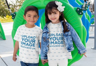 Sublimated Tee Mockup Featuring Two Smiling Kids at a Playground 31665