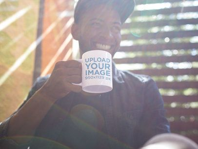 Mug Mockup of a Young Man Smiling at a Coffee Shop a12295