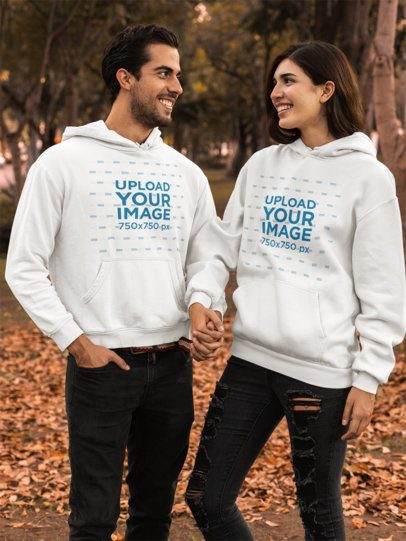 Pullover Hoodie Mockup Featuring a Couple by Brown Leaves 31805