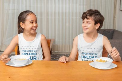 Mockup of a Girl and a Boy Wearing Tank Tops at Home 32358