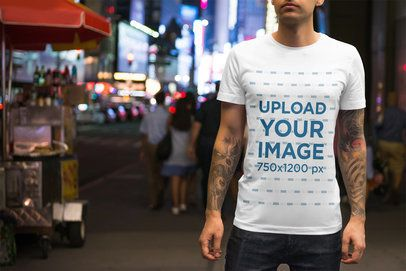 T-Shirt Mockup of a Tattooed Man on a Busy Street 3355-el1