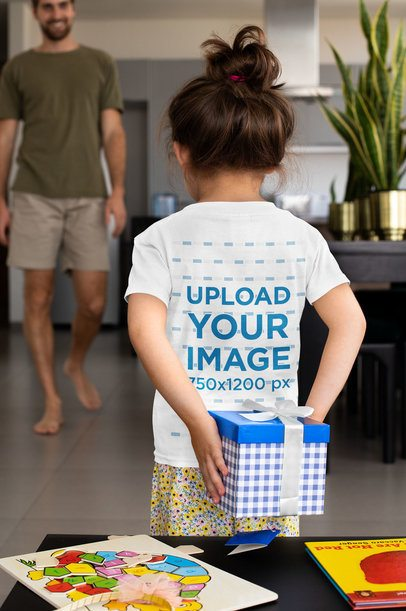 Back View T-Shirt Mockup Featuring a Little Girl Holding a Present for Her Dad 33059