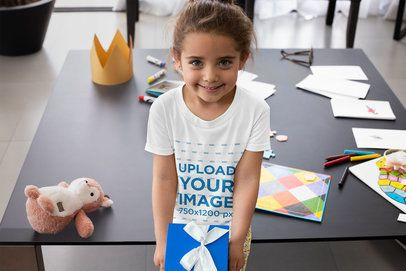 T-Shirt Mockup of a Little Girl Holding a Present on Father's Day 33081