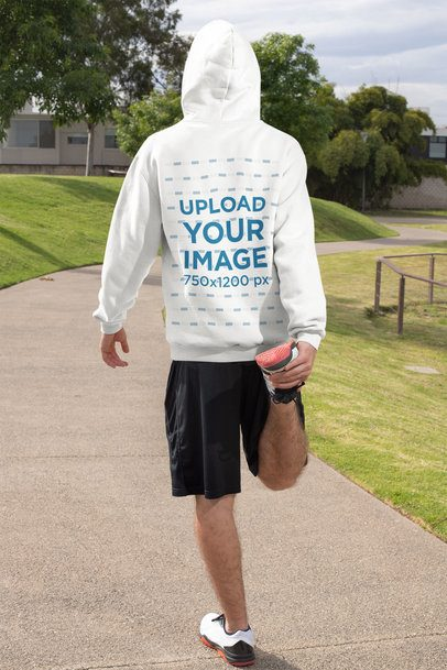 Hoodie Mockup of the Back View of a Man Getting Ready to Run 32315