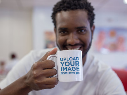 Young Man Smiling with his Mug at a Diner a12330
