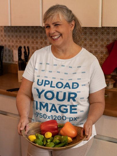 T-Shirt Mockup of a Smiling Woman in the Kitchen 32195