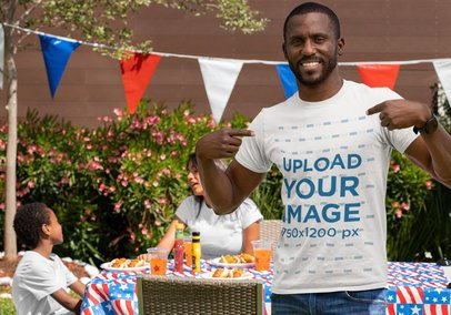 Mockup of a Man on a 4th of July Party Pointing at His T-Shirt 33013
