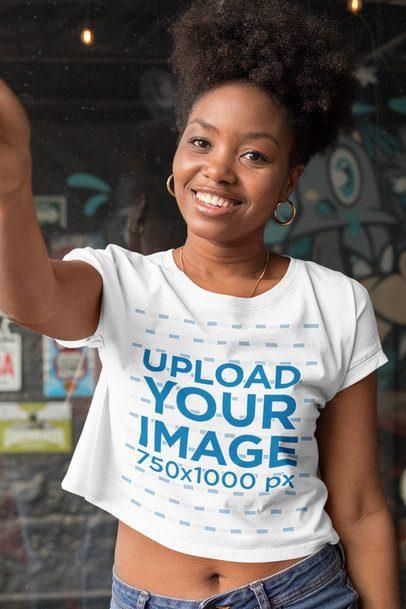 Selfie Mockup of a Smiling Woman Wearing a Crop Top Tee 32295