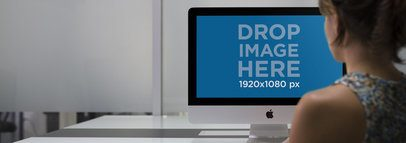 iMac Mockup of a Young Woman in her Office a12341
