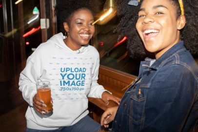 Hoodie Mockup Featuring a Woman Talking to Her Friend at a Bar 32302
