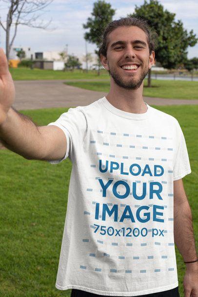 T-Shirt Mockup of a Smiling Man Taking a Selfie 32321
