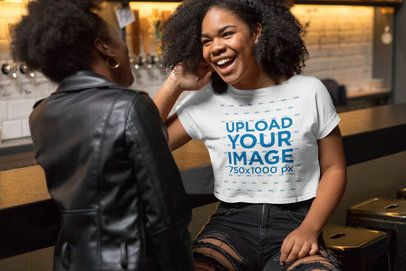 Crop Top Mockup Featuring a Joyful Woman Talking With a Friend at a Bar 32293