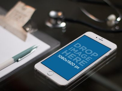 White iPhone Mockup Lying on a Doctor's Office Desk a12319
