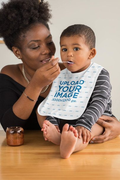 Bib Mockup Featuring a Mother Feeding Her Baby Boy 32542