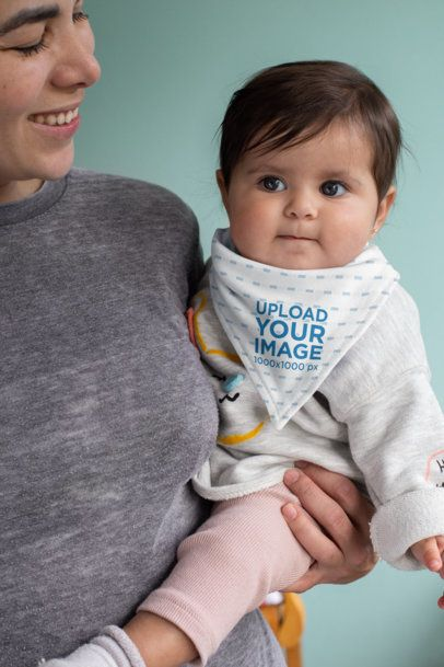 Bib Mockup Featuring a Baby with Her Mom 32471