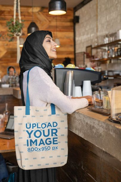 Tote Bag Mockup of a Woman Wearing a Hijab at a Cafe 32395