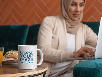11 oz Coffee Mug Mockup Featuring a Woman Working on the Computer 32405