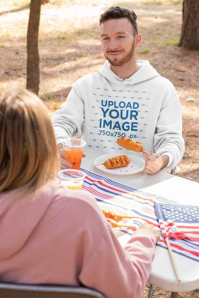 Hoodie Mockup Featuring a Man Eating a Corn Dog 33038