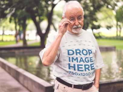 Senior Man Out by the Pond Wearing a Round Neck Tee Mockup b12384
