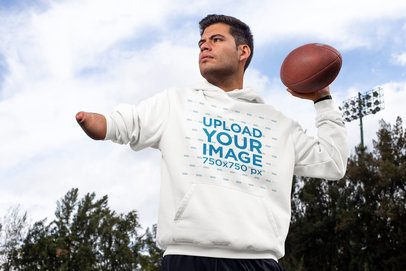 Hoodie Mockup of a Man Throwing a Football 32499