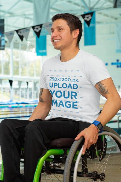 T-Shirt Mockup of an Athlete Using a Wheelchair by a Pool 32485
