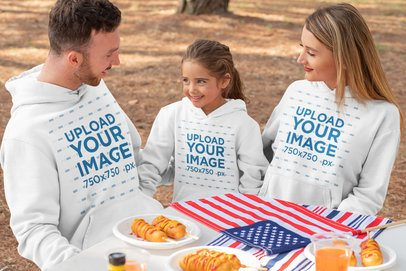 Hoodie Mockup of a Family Eating Together on the 4th of July 33039