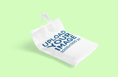 Mockup of a Customizable Plastic Bag Lying on a Plain Color Surface 3470-el1