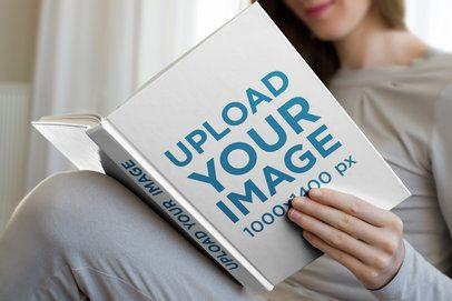 Hardcover Book Mockup of a Woman Reading 3409-el1