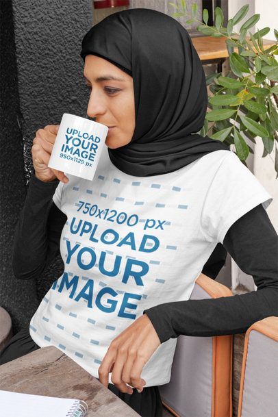 T-Shirt Mockup of a Relaxed Woman with a Hijab Drinking from an 11 oz Mug 32402