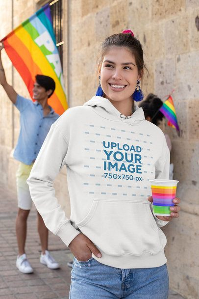 Hoodie Mockup Featuring a Woman Smiling During a Pride Parade 33000