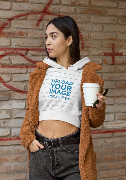 Hoodie Crop Top Mockup Featuring a Woman with a Coffee on Her Hand 32462