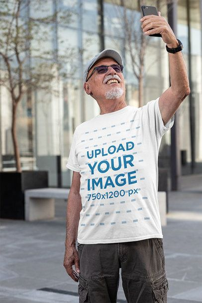 T-Shirt Mockup of a Senior Man Taking a Selfie 32887