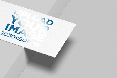 Mockup of a Varnish Business Card Balanced on a Border 33775