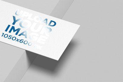 Mockup of a Varnish Business Card Balanced on a Border 33775