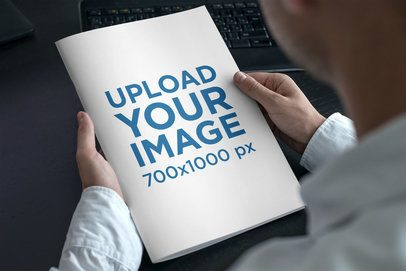 Mockup of a Magazine in the Hands of a Man with a Blue Shirt 3384-el1