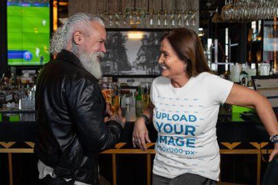 T-Shirt Mockup of a Woman Talking to a Bearded Man at a Bar 32869