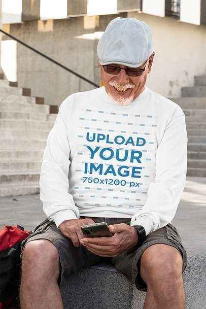 Long Sleeve Tee Mockup Featuring an Elderly Man Checking His Phone 32875