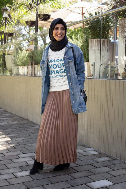 T-Shirt Mockup of a Woman with a Hijab on the Street 32421