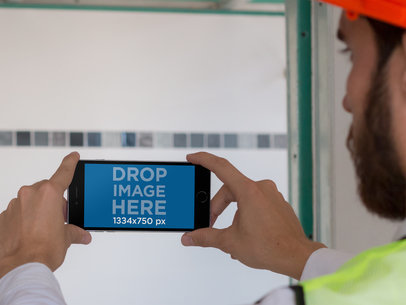 iPhone 6 Mockup in Landscape View Featuring an Architect a12422wide
