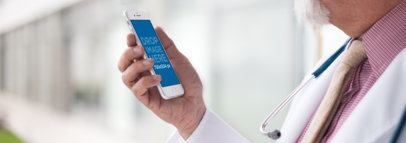 White iPhone Mockup Held by an Old Doctor at a Hospital a12437wide