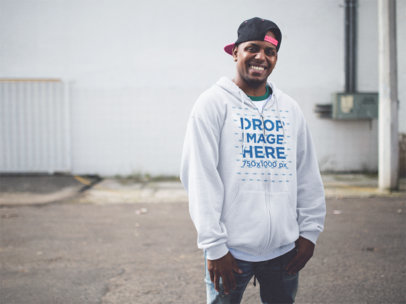 Zip Up Hoodie Mockup Featuring a Young Black Man Wearing a Snapback a12460