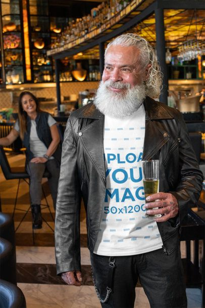 T-Shirt Mockup of a Smiling Senior Holding a Glass at a Bar 32873