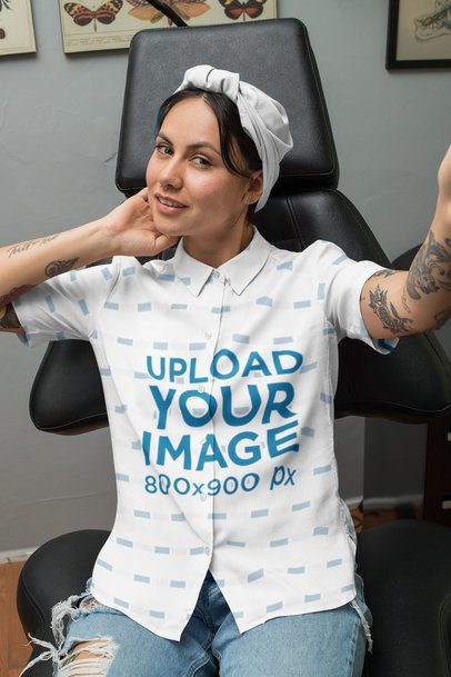Button-Up Shirt Mockup of a Woman Taking a Selfie in a Tattoo Studio 33153