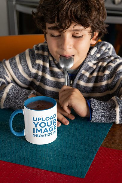 Mockup of a Boy Staring at an 11 oz Coffee Mug With a Colored Rim 33164