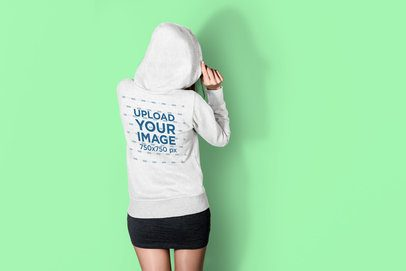 Back View Hoodie Mockup Featuring a Woman at a Studio 3576-el1