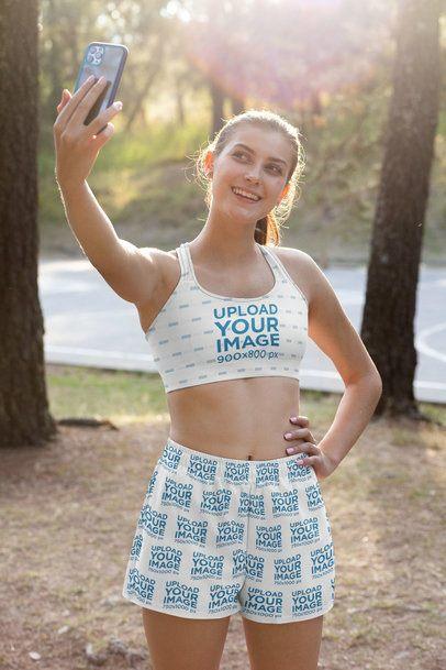 Sports Bra Mockup of a Woman Wearing Shorts Taking a Selfie 33089